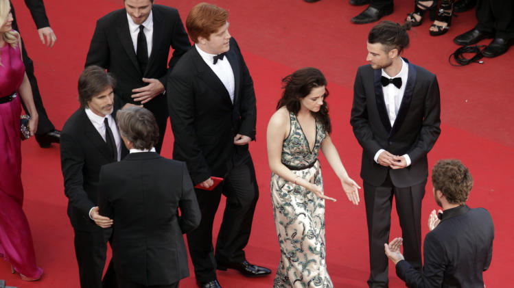 Actress Kristen Stewart, center, arrives -for the screening of On the Road at the 65th international film festival, in Cannes, southern France, Wednesday, May 23, 2012. (AP Photo/Virginia Mayo, Pool)