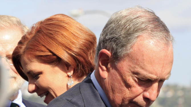 In this Sept. 20, 2012, photo, New York Mayor Michael Bloomberg, right, and City Council Speaker Christine Quinn participate in a ceremony in New York. Quinn is one of several possible candidates to run for mayor in 2013. Some of the city's top political players are already jockeying for position, preparing to introduce themselves to voters who haven't paid much attention to who will succeed Michael Bloomberg, the billionaire mayor who has defined City Hall for more than a decade. (AP Photo/Mark Lennihan)
