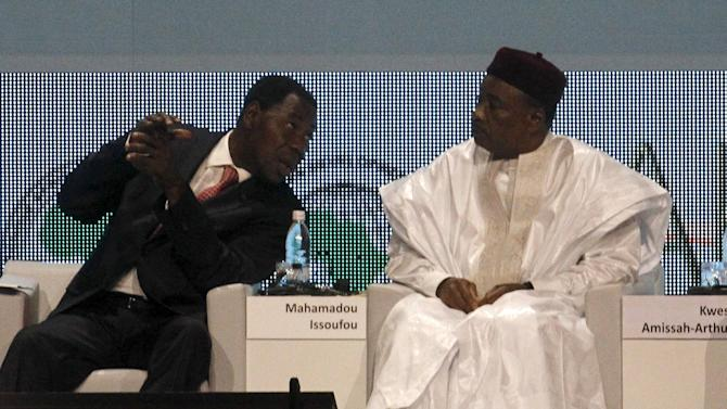 Benin's President Thomas Boni Yayi talks to Niger's President Mahamadou Issoufou during the opening ceremony of the annual meeting commemorating the 50th anniversary of the African Development Bank in Abidjan