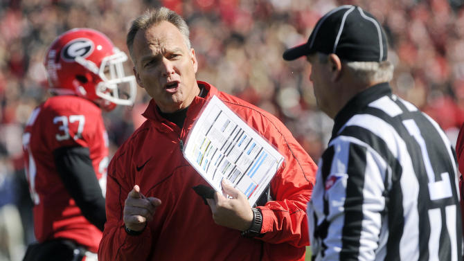 Georgia head coach Mark Richt argues with an official during the first half of an NCAA college football game against Georgia Tech, Saturday, Nov. 24, 2012, in Athens, Ga. (AP Photo/John Amis)