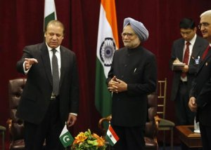 Pakistan's PM Sharif gestures as India's PM Singh looks on, during the United Nations General Assembly in New York