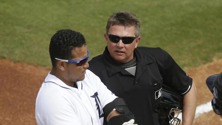 Detroit Tigers' Miguel Cabrera talks with home plate umpire Greg Gibson after getting called out on strikes during the second inning of a spring exhibition baseball game against the Toronto Blue Jays in Lakeland, Fla., Tuesday, March 11, 2014