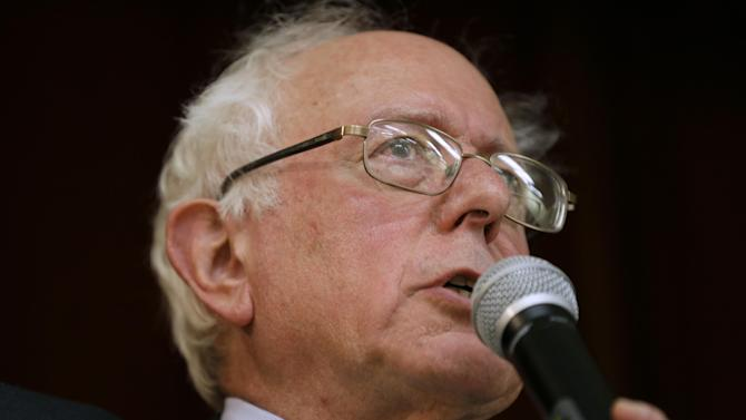 """FILE - This Dec. 16, 2014, file photo, Sen. Bernie Sanders, I-Vt., speaks during a town hall meeting in Ames, Iowa. Sanders says he'll decide by March whether to launch a 2016 presidential campaign. He says if he does, it won't just be to nudge the debate to the left. Sanders, a socialist, tells The Associated Press he won't get into the race unless he thinks he can win. At a time of increasing wealth inequality, a populist message of taking on """"the billionaire class"""" might resonate, he says. (AP Photo/Charlie Neibergall, File)"""