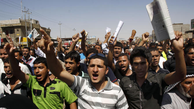 Followers of anti-American Shiite cleric Muqtada al-Sadr chant slogans during a rally demanding better public services, food supplies and more jobs in nationwide protests to pressure their government, in Basra, Iraq's second-largest city, 550 kilometers (340 miles) southeast of Baghdad, Iraq, Friday, Sept. 16, 2011. (AP Photo/Nabil al-Jurani)