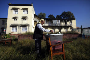 A Nepalese voter casts his vote at a polling station …
