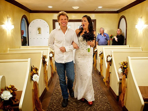Jon Bon Jovi walks one of his fans down the aisle.