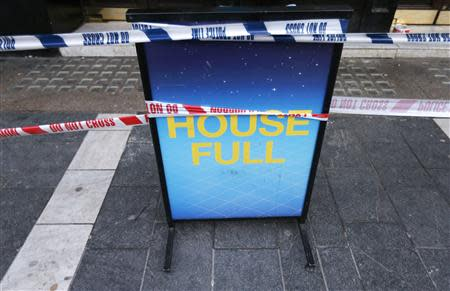 A notice board is wrapped in police tape outside the Apollo theatre on the morning after part of it's ceiling collapsed on spectators as they watched a performance, in central London