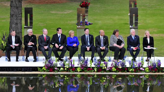 """Tearful ceremony remembers anniversary of 1995 Oklahoma City bombing About 1,000 people gathered Sunday to commemorate the 20th anniversary of the Oklahoma City bombing, which was the deadliest terrorist attack on U.S. soil until the Sept. 11 attacks six years later. Former President Bill Clinton and Oklahoma Gov. Mary Fallin were among those who spoke at Sunday's service at the Oklahoma City National Memorial, where the Alfred P. Murrah Federal Building once stood. The service started with a 168-second moment of silence to honor each of the 168 people who died in the April 19, 1995, attack. It concluded about 90 minutes later with survivors and tearful relatives of the dead reading the names of those killed. """"This was a place of unspeakable horror and tragedy,"""" Frank Keating, who was Oklahoma's governor at the time of the attack, told the gathering. He called the attack """"unforgivable."""" Timothy McVeigh, an Army veteran with strong anti-government views, planned the bombing as revenge for the deadly standoff between the FBI and Branch Davidians in Waco, Texas, that killed more than 70 people on April 19, 1993 — exactly two years earlier. McVeigh was convicted on federal murder and conspiracy charges in 1997 and executed in 2001.His Army buddy, Terry Nichols, was convicted on federal and state bombing-related charges and is serving multiple life sentences in a federal prison. (AP)   Photo credits: (from top)   Sue Ogrocki/AP Photo, Nick Oxford/Reuters, Sue Ogrocki/AP Pho to, Nick Oxford/Reuters (2)   See more photos from the 20th anniversary of the Oklahoma City bombing and our other slideshows on Yahoo News."""
