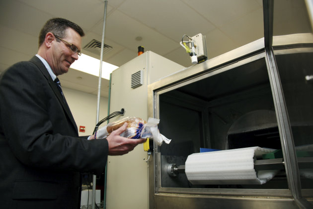 <p>               In this Dec. 6, 2012, photo, Don Stull, chief executive officer of Microzap, Inc., places a loaf of bread inside a patented microwave that kills mold spores in Lubbock, Texas. The company claims the technology allows bread to stay mold-free for 60 days. (AP Photo/John Mone)