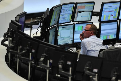 <p>A trader sits in front of screens showing the German DAX index in Frankfurt in 2011. The eurozone crisis is increasingly hitting the German economy, the leader in Europe, data suggested on Monday as German business confidence fell for the fifth month in a row to the lowest level since February 2010.</p>