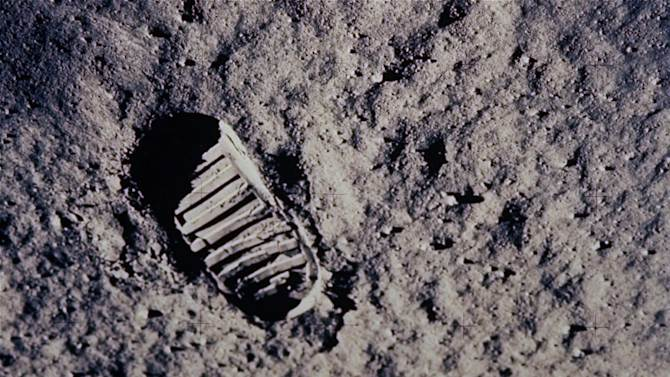 """FILE - In this July 20, 1969 file photo, a footprint left by one of the astronauts of the Apollo 11 mission shows in the soft, powder surface of the moon. Commander Neil A. Armstrong and Air Force Col. Edwin E. """"Buzz"""" Aldrin Jr. became the first men to walk on the moon after blastoff from Cape Kennedy, Fla., on July 16, 1969.  The family of Neil Armstrong, the first man to walk on the moon, says he died Saturday, Aug. 25, 2012, at age 82. A statement from the family says he died following complications resulting from cardiovascular procedures. It doesn't say where he died. Armstrong commanded the Apollo 11 spacecraft that landed on the moon July 20, 1969. He radioed back to Earth the historic news of """"one giant leap for mankind."""" Armstrong and fellow astronaut Edwin """"Buzz"""" Aldrin spent nearly three hours walking on the moon, collecting samples, conducting experiments and taking photographs. In all, 12 Americans walked on the moon from 1969 to 1972.  (AP Photo/NASA)"""