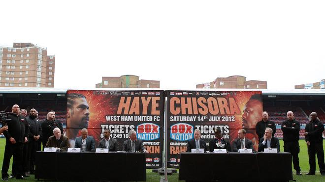 David Haye (L) And Dereck Chisora Are Separated By A Fence Getty Images
