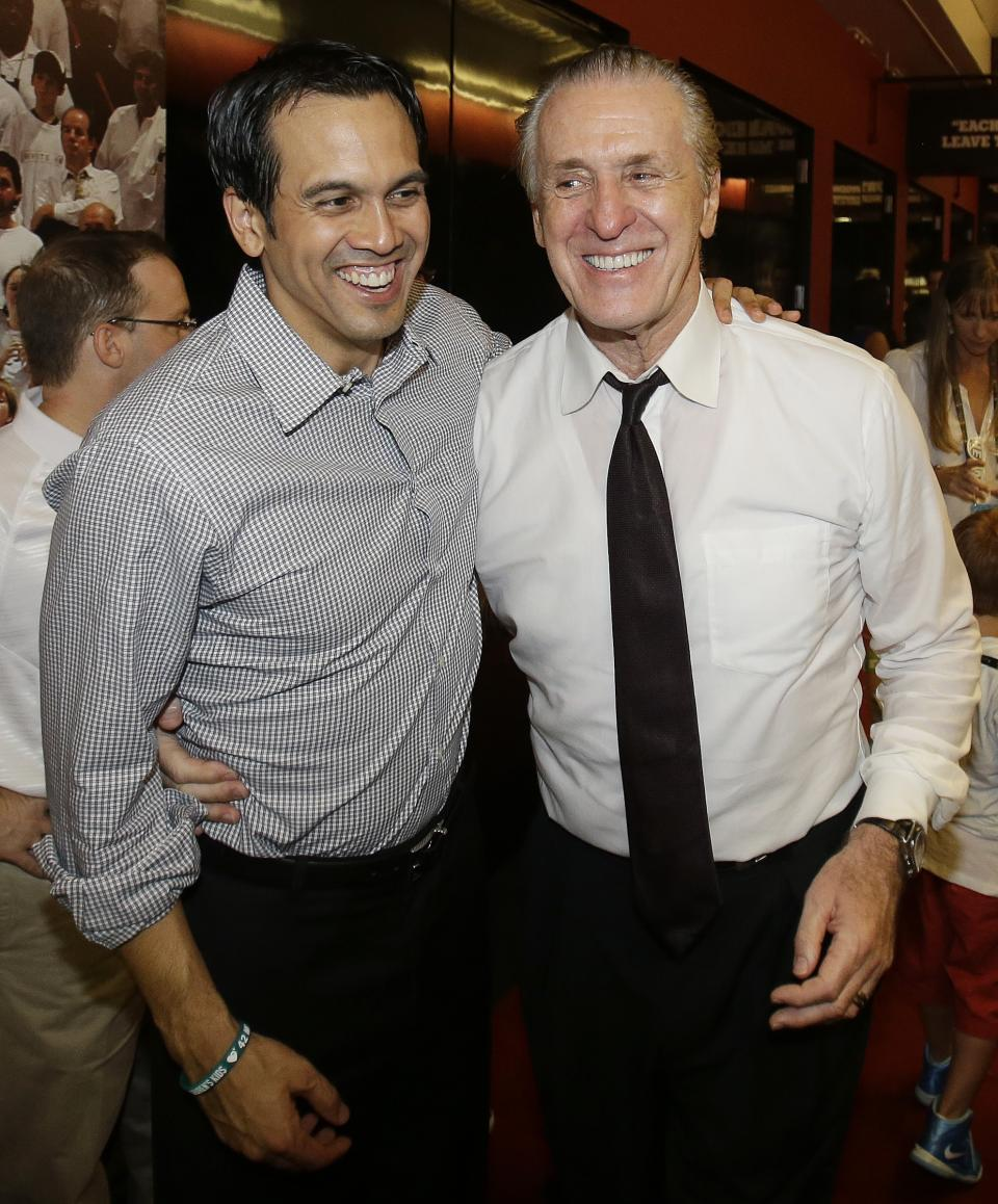 Miami Heat President Pat Riley, right, and head coach Erik Spoelstra celebrate the team's second NBA championship, Friday morning, June 21, 2013, in Miami. The Miami Heat defeated the San Antonio Spurs 95-88 to win their second straight NBA championship. (AP Photo/Wilfredo Lee)