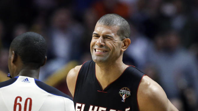 Miami Heat forward Shane Battier grimaces after he was called for a foul during the second half of an NBA basketball game against the Chicago Bulls in Chicago on Wednesday, March 27, 2013. The Bulls won 101-97, ending the Heat's 27-game winning streak. (AP Photo/Nam Y. Huh)