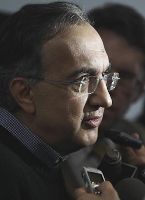 FILE - In this May 23, 2011 file photo, Chrysler CEO Sergio Marchionne addresses the media at the opening of the Fiat of Lakeside dealership in Macomb Township, Mich. Marchionne said Friday, Oct. 28, 2011, that the carmaker's two-class wage system has to go, potentially setting the stage for a fight over wages when all three U.S. automakers and their largest union head back to negotiating tables in 2015. (AP Photo/Carlos Osorio, File)