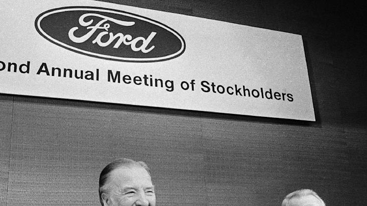 FILE - In a May 12, 1977 file photo, Ford Chairman of the Board Henry Ford II, center, shuffles papers before calling the Ford Motor Company's annual stockholders meeting to order in Detroit. At Ford's left is Philip Caldwell, vice chairman of the board. Cauldwell, the first person to lead Ford Motor Co. who wasn't a member of the founding family, died Wednesday, July 10, 2013 at his home in New Canaan, Conn., at the age of 93. (AP Photo/Richard Sheinwald, File)