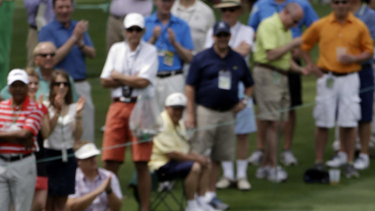 Rory McIlroy, of Northern Ireland, reacts after nearly chipping in on the second green during the first round of the Masters golf tournament Thursday, April 11, 2013, in Augusta, Ga. (AP Photo/David Goldman)