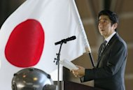 <p>Japan's Prime Minister, Shinzo Abe, pictured at Naha air base on southern island of Okinawa, on February 2, 2013. The radar-lock that a Chinese frigate put on a Japanese warship was 'dangerous' and 'provocative,' Abe said on Wednesday, as tensions in a territorial row ratcheted up.</p>