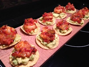Tostadas with avocado, & shrimp ready to decorate with cilantro