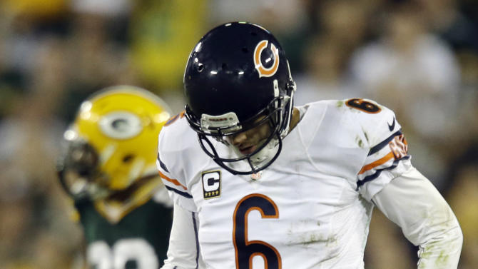 Chicago Bears' Jay Cutler walks off the field after being sacked during the second half of an NFL football game against the Green Bay Packers Thursday, Sept. 13, 2012, in Green Bay, Wis. The Packers won 23-10. (AP Photo/Jeffrey Phelps)