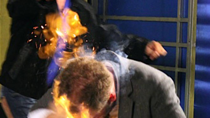 """In this picture released by American magician Wayne Houchin, Houchin's head burns while taping """"Closer To The Stars"""" TV program in Santo Domingo, Dominican Republic, Monday, Nov. 26, 2012. Houchin, of Chico, California, is receiving treatment for burns after a local television show host, Franklin Barazarte, lit his head on fire with a flammable cologne while taping the TV program. (AP Photo)"""
