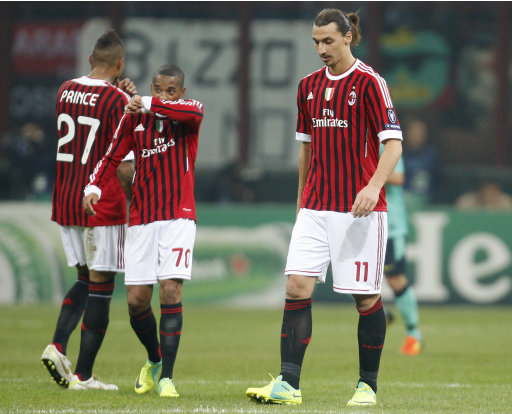 AC Milan forward Zlatan Ibrahimovic, right, Brazilian forward Robinho, center, and midfielder Kevin Prince Boateng react after Barcelona forward Lionel Messi scored during a Champions League, group H, soccer match between AC Milan and Barcelona at the San Siro stadium in Milan, Italy, Wednesday, Nov. 23, 2011. (AP Photo/Antonio Calanni)