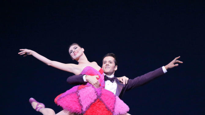 """This Thursday, Sept. 20, 2012 image released by the New York City Ballet shows Tiler Peck, left, and Robert Fairchild performing in """"Not My Girl"""" at the New York City Ballet fall gala, with costumes designed by Valentino Garavani in New York. (AP Photo/New York City Ballet, Paul Kolnik)"""