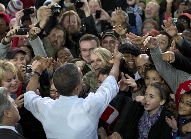 President Barack Obama greets people in the crowd after speaking at a campaign event at the Summerfest Grounds at Henry Maier Festival Park, Saturday, Sept. 22, 2012, in Milwaukee. (AP Photo/Carolyn Kaster)