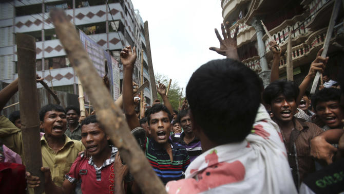"Protestors march down the street, demanding the death penalty for those responsible for the April 24 collapse of a garment factory building that killed hundreds in Savar, near, Dhaka, Bangladesh, Tuesday, April 30, 2013. A top Bangladesh court on Tuesday ordered the government to ""immediately"" confiscate the property of a collapsed building's owner, as thousands of protesters demanding death penalty for the man clashed with police, leaving 100 people injured. (AP Photo/Wong Maye-E)"