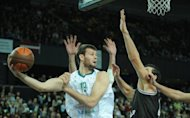 Britain&#39;s Joel Freeland (L) during a Euroleague basketball match in January. Great Britain, 350-1 underdogs to win gold in London, have just two NBA players on their roster, the 6ft 10in forward Freeland and Chicago Bulls All Star Luol Deng