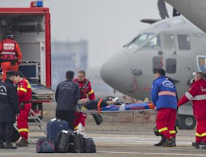A man is stretchered out of a military transport aircraft …