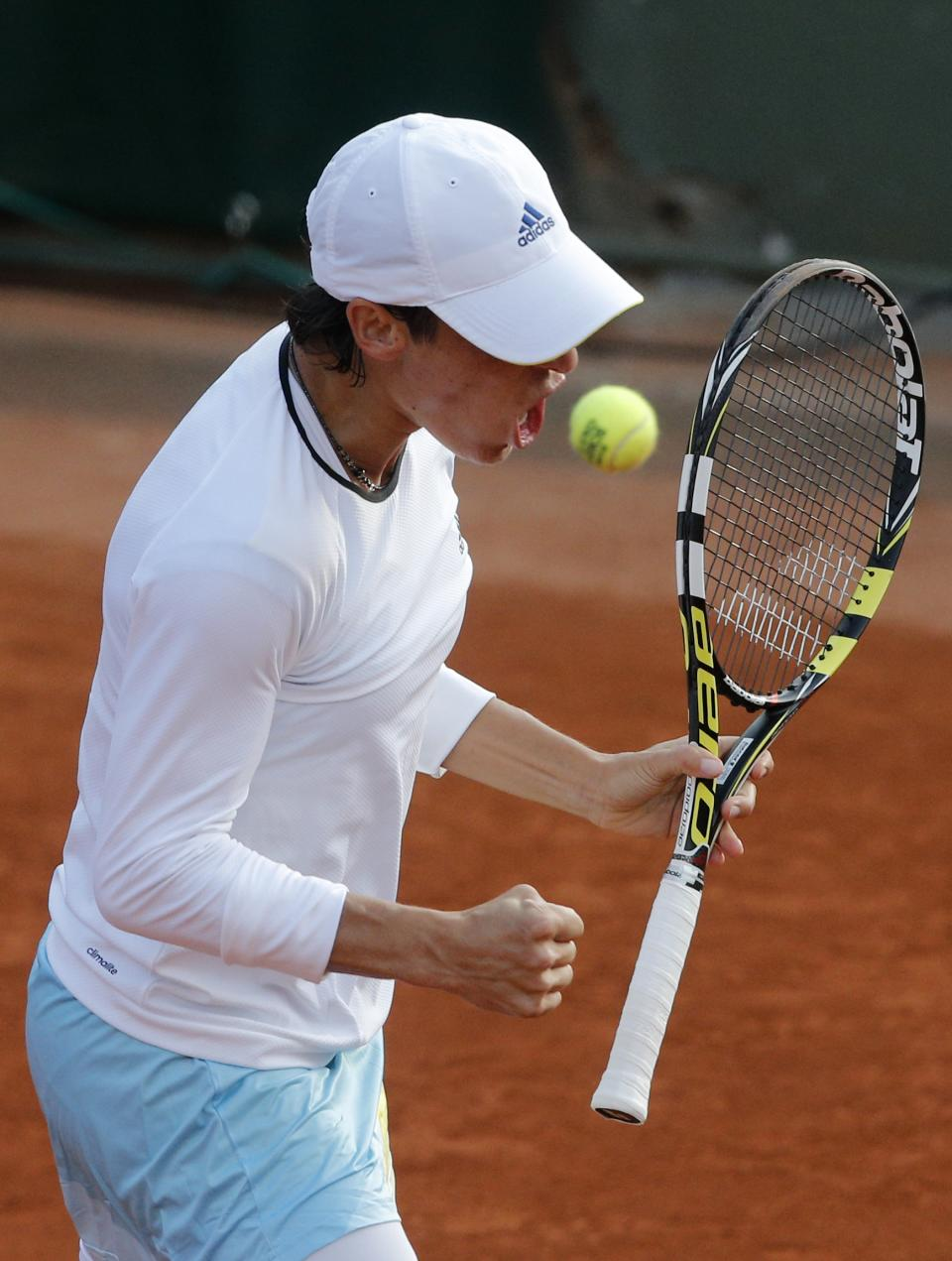 Italy's Francesca Schiavone reacts as she defeats Hungary's Melinda Czink during their first round match of the French Open tennis tournament at the Roland Garros stadium Monday, May 27, 2013 in Paris. (AP Photo/Michel Spingler)