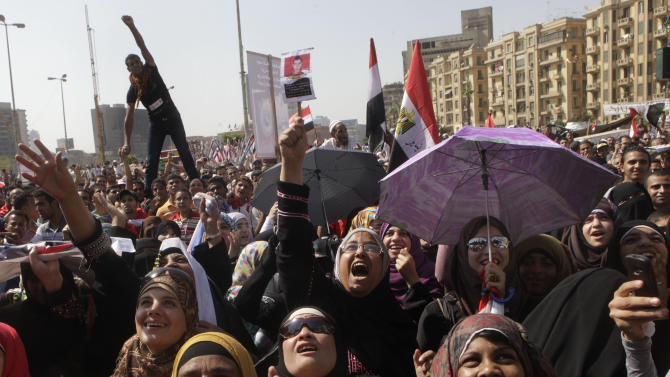 Egyptian protesters shout slogans at a protest in Tahrir Square, Cairo, Egypt Friday, June 8, 2012. Hundreds gathered in Cairo's Tahrir Square, the focal point of Egyptian uprising, to demonstrate against presidential candidate Ahmed Shafiq, Hosni Mubarak's last prime minister, ahead of a run-off vote. (AP Photo/Amr Nabil)