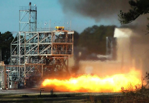 In this image taken from video, NASA engineers test fire a key part of a rocket engine left over from the 1960s-era Apollo moon missions on Thursday, Jan. 24, 2013, in Huntsville, Ala. Engineers hope