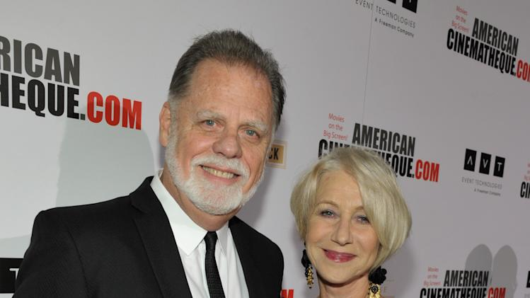 Taylor Hackford, left, and Helen Mirren attend the presentation of the 27th Annual American Cinematheque Award to Jerry Bruckheimer on Thursday, Dec. 12, 2013, in Beverly Hills, Calif. (Photo by John Shearer/Invision for American Cinematheque/AP Images)