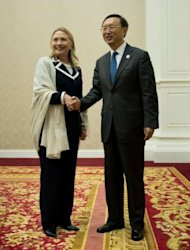 US Secretary of State Hillary Clinton (L) shakes hands with Chinese Foreign Minister Yang Jiechi. Clinton and Yang pledged to work more closely together after talks designed to soothe their countries&#39; often spiky relations