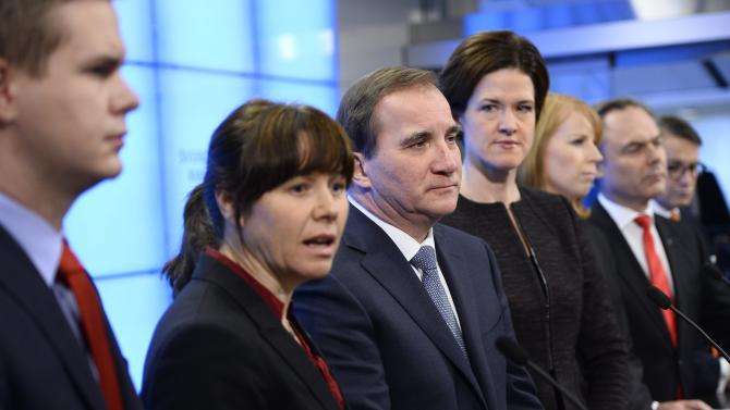 From Left to Right:  Green Party spokesperson Gustav Fridolin, Green Party spokesperson Åsa Romson, PM and Social Democratic Party  leader Stefan Löfven, Moderate Party leader-elect Anna Kinberg Batra, Centre Party leader Annie Lööf, Liberal Party leader Jan Björklund and Christian Democrat leader Göran Hägglund pictured during a press conference at the Swedish Parliament in Stockholm, Sweden, December 27, 2014. During the presser the parties announced that a 'December agreement' on how to rule with a minority government in the parliament, has canceled the plans to run a snap election in March 2015.  (AP Photo / Henrik Montgomery / TT)  SWEDEN OUT