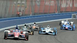 Takuma Sato (14), from Japan, leads during the early…