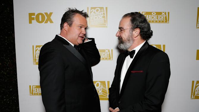 Actors Eric Stonestreet, left, and Mandy Patinkin attend the Fox Golden Globes Party on Sunday, January 13, 2013, in Beverly Hills, Calif. (Photo by Todd Williamson/Invision for Fox Searchlight/AP Images)