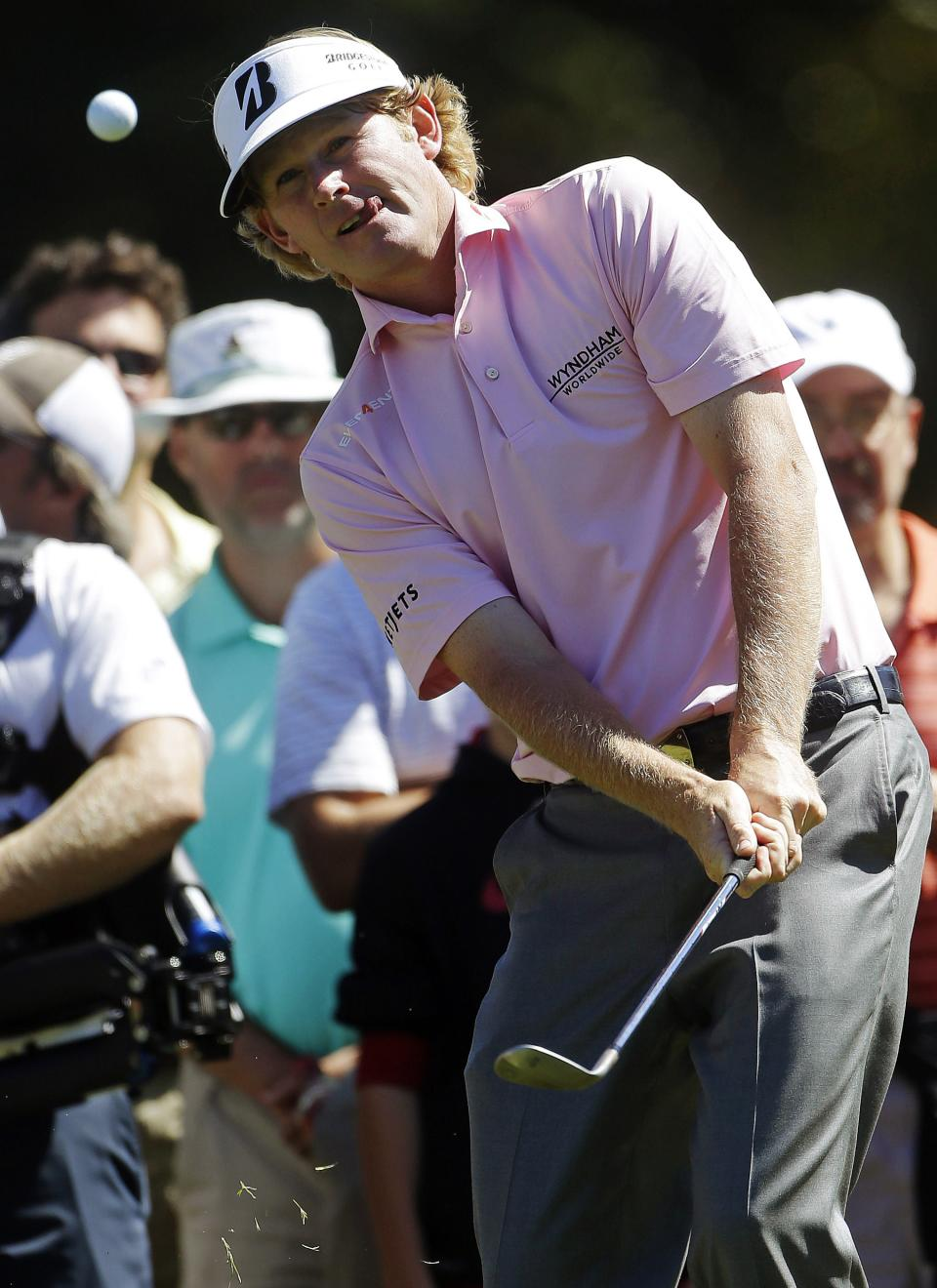 Brandt Snedeker chips to the green on the fourth hole during the final round of play in the Tour Championship golf tournament in Atlanta, Sunday, Sept. 23, 2012. (AP Photo/John Bazemore)