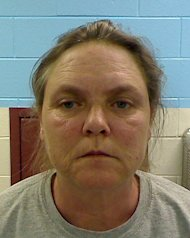 This photo released by the Etowah County Sheriff's Dept. on Wednesday, Feb. 22, 2012 shows Joyce Hardin Garrard, 46. Garrard and 27-year-old Jessica Mae Hardin, grandmother and stepmother of a 9-year-old Alabama girl who died after witnesses said she was forced to run for three hours as punishment for lying, have been charged with murder and are being held in jail. (AP Photo/Etowah County Sheriff's Office)