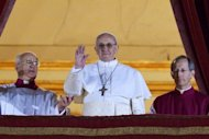 <p>Argentinian cardinal Jorge Bergoglio appears on the balcony of St Peter's Basilica after being elected the 266th pope of the Roman Catholic Church on March 13, 2013 at the Vatican. Pope Francis arrived at a Rome basilica on Thursday for a private prayer on his first full day as the leader of the Roman Catholic Chuch, following his historic election.</p>