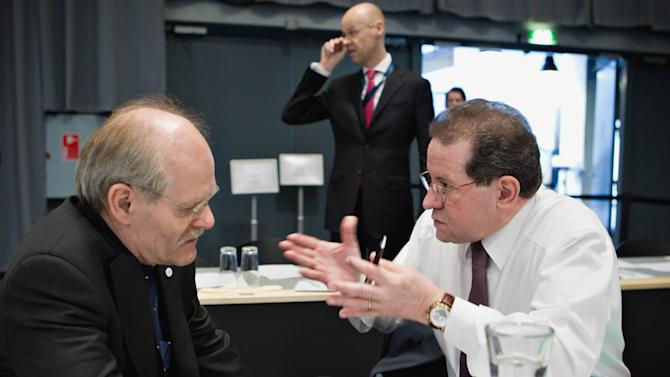 Governor of the Central Bank of Sweden Stefan Ingves, left, and Vice-President of European Central Bank, ECB, Vitor Constancio, right, prepare for the second day of a eurozone finance ministers meeting, in Copenhagen, Denmark Saturday March 31, 2012. Several European finance chiefs said Friday the 17 countries that use the euro are unlikely to boost their financial backstop to the Euros1 trillion ($1.3 trillion) demanded by many of their international partners. (AP Photo/Lars Krabbe/Polfoto) DENMARK OUT