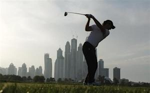 Molinari from Italy takes his tee shot on the 8th hole during the first round of the 2014 Omega Dubai Desert Classic in Dubai