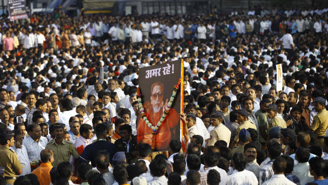 "FILE - In this Nov. 18, 2012 file photo, Indian mourners carry a poster of Hindu hardline Shiv Sena party leader Bal Thackeray with the words ""Long Live"" during his funeral in Mumbai, India. Indian media say police in Mumbai have arrested two girls who posted a comment on a social networking site criticizing the shutdown of India's financial hub following the death of a Hindu fundamentalist politician over the weekend. (AP Photo/Rafiq Maqbool, File)"