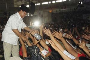 Indonesian presidential candidate Prabowo Subianto greets supporters during a campaign rally in Medan, North Sumatra