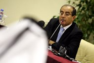 Mahmoud Jibril, the number two in the National Transitional Council of Libya, speaks during a press conference in Doha, Qatar, on Tuesday, Aug. 23, 2011, hours after rebel forces overran Libyan leader Moammar Gadhafi's fortified Bab al-Azizya headquarters in the capital Tripoli, following heavy fighting. (AP Photo/Osama Faisal)