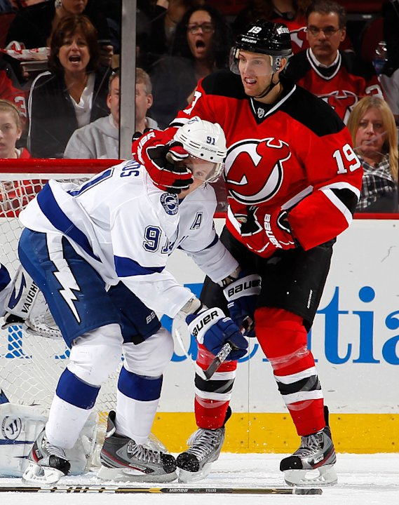 Travis Zajac #19 Of The New Jersey Devils Takes A Handful Of The Helmet Of Steven Stamkos #91 Of The Tampa Bay Getty Images