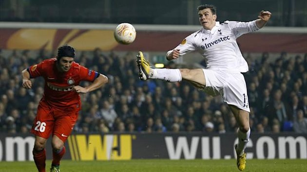 Tottenham's Gareth Bale challenges for the ball against Inter Milan (Reuters)