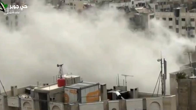 In this Tuesday, April 2, 2013 image taken from video obtained from Shaam News Network, which has been authenticated based on its contents and other AP reporting, shows smoke from heavy shelling in the Jobar neighborhood in north Damascus, Syria. Syrian government warplanes and artillery pounded Damascus and its suburbs Tuesday, as rebels in the northern city of Aleppo launched an operation that aims to free hundreds of political detainees from the city's central prison, activists said. (AP Photo/Shaam News Network)